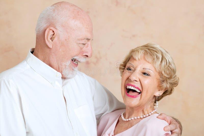 Старшии смеясь над совместно стоковая фотография rf