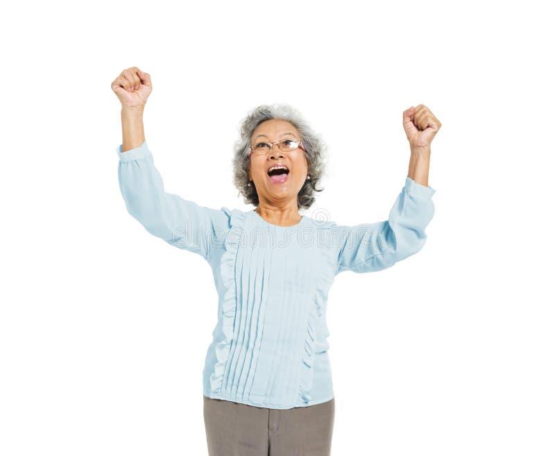 Старший взрослый праздновать на белой предпосылке стоковые фото
