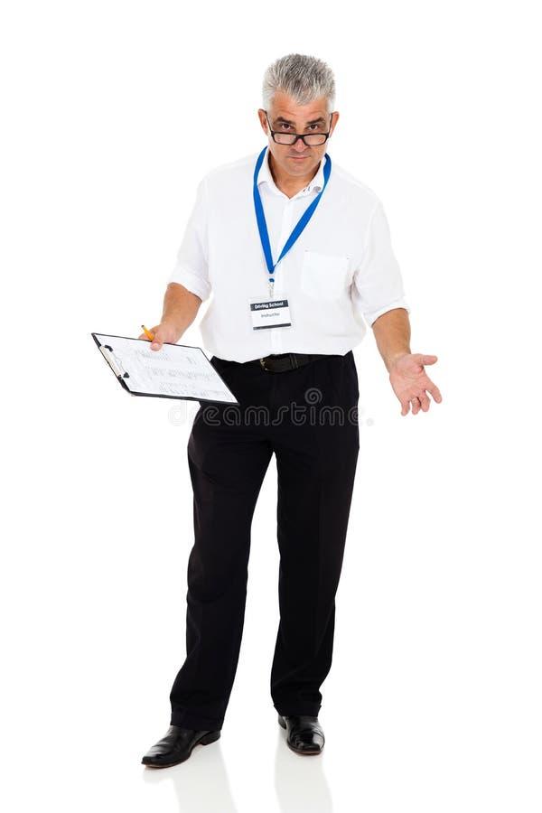 Старший инструктор по вождению стоковое изображение rf
