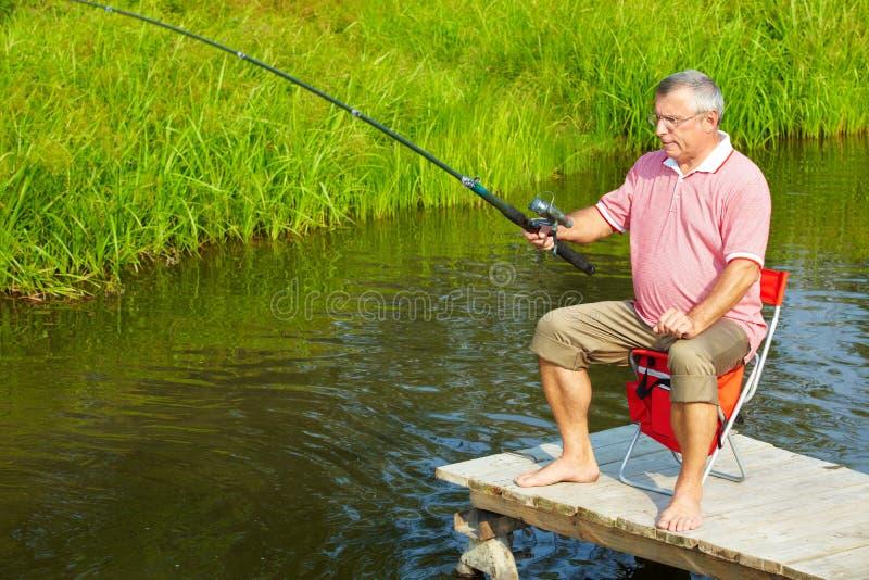 старший человека рыболовства стоковая фотография rf