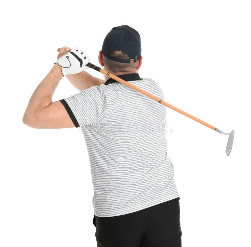 Старший человек играя гольф на белизне стоковые фото