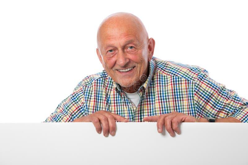 Старший человек с пустой доской стоковое фото rf