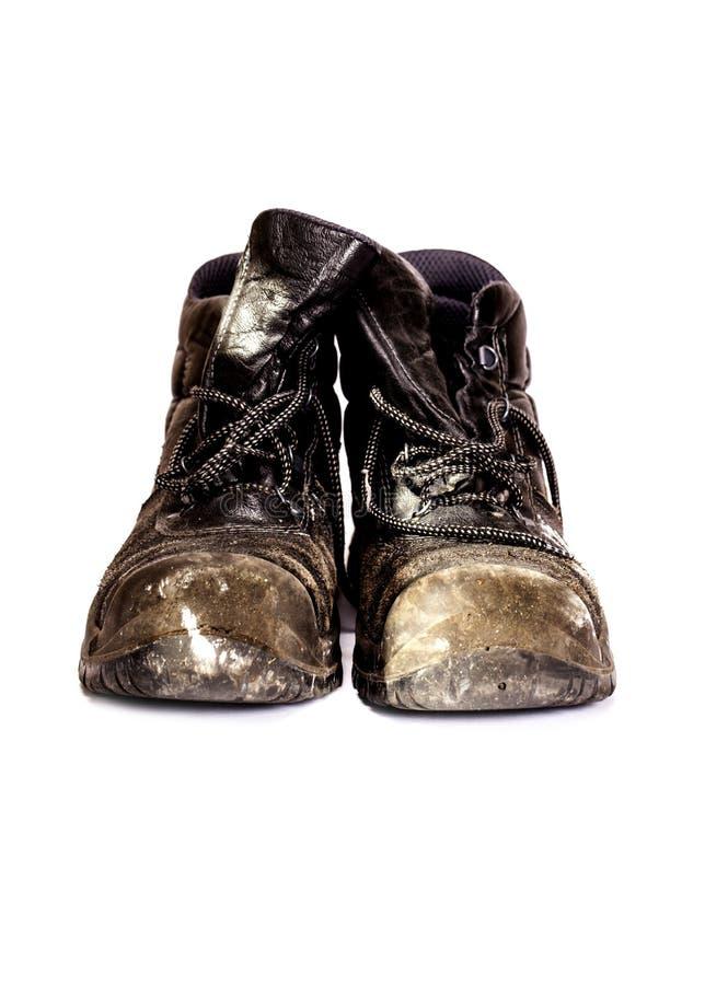 Старые ботинки работников. стоковое фото rf