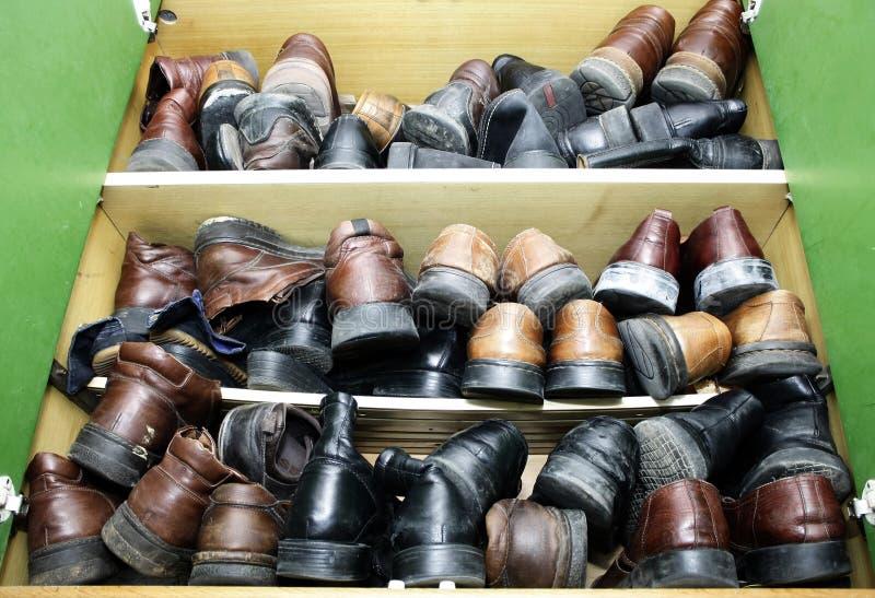 Старые ботинки стоковые изображения