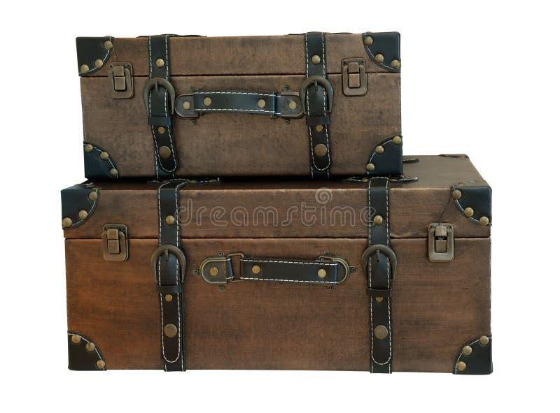 Старые винтажные чемоданы сумки на предпосылке изолята (путь клиппирования) стоковое изображение