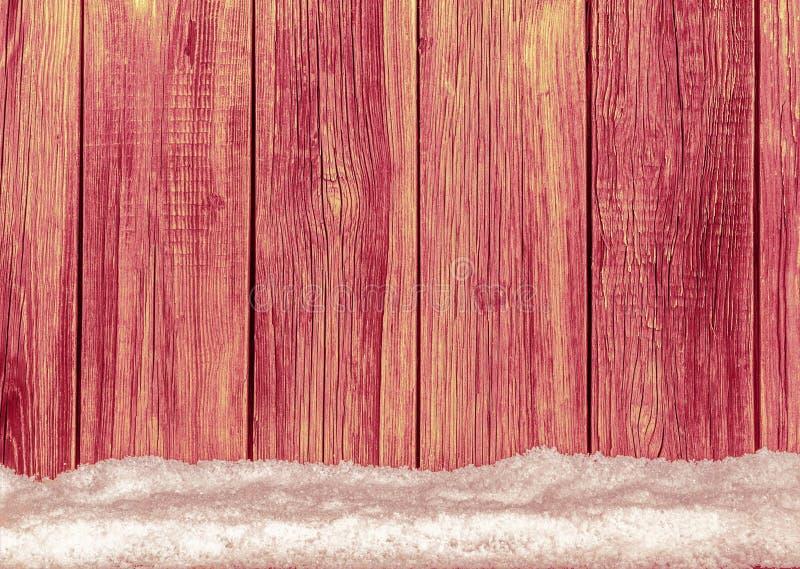Старые деревянные доски и белая предпосылка снега стоковая фотография