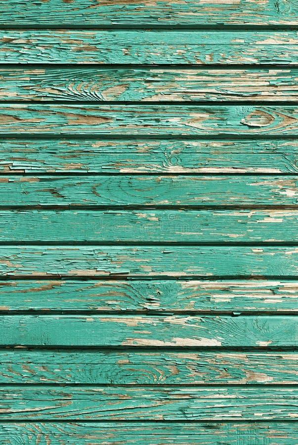 Старые затрапезные деревянные планки с треснутой краской, ретро деревянной предпосылкой стоковое фото rf
