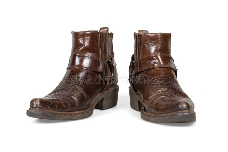 Старые и worn ботинки ковбоя стоковые изображения