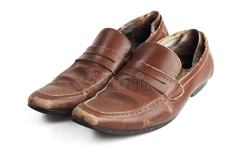 Старые коричневые кожаные ботинки стоковая фотография