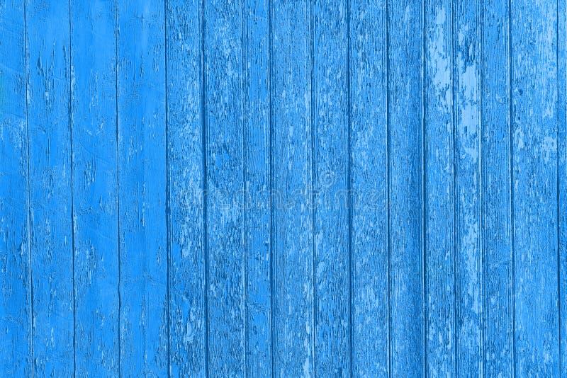 Старые, который слезли деревянные планки с треснутой краской цвета, панели предпосылки старые стоковые изображения