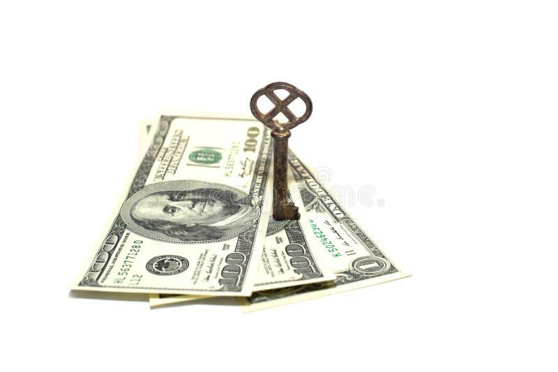 Старые немного долларов США банкнот ключевых и на белой предпосылке стоковая фотография rf