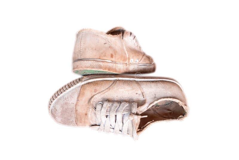 Старые несенные вне ботинки холста школы стоковое изображение