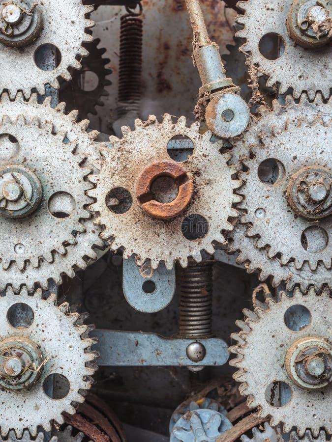 Старые пакостные выдержанные cogwheels стоковая фотография rf