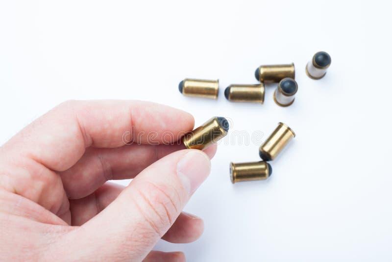 Старые резиновые пули в руке стоковая фотография rf