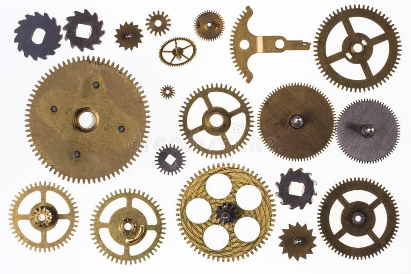 Старые cogs clockwork и изолированные части часов - стоковое изображение rf
