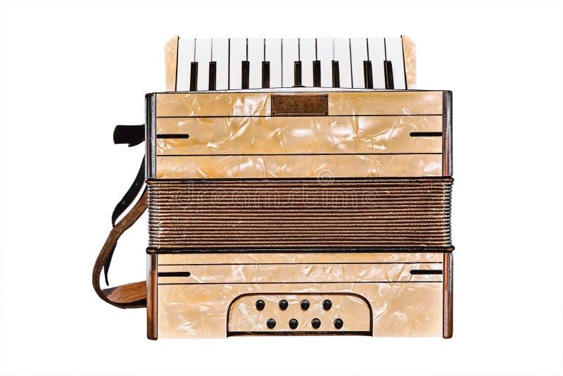 Старый аккордеон на белом стоковое фото