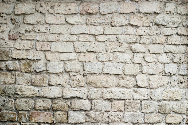 Старый белый крупный план кирпичной стены стоковое фото