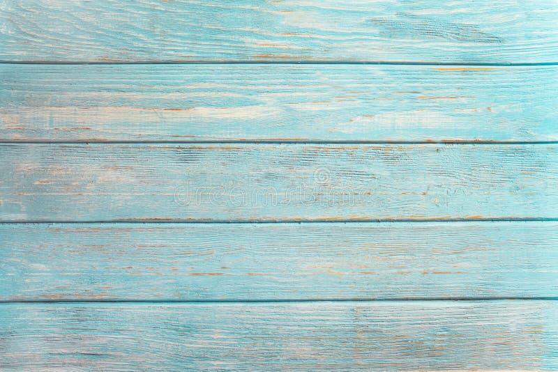 Старый выдержал деревянная планка покрашенная в бирюзе или голубом цвете моря стоковое фото
