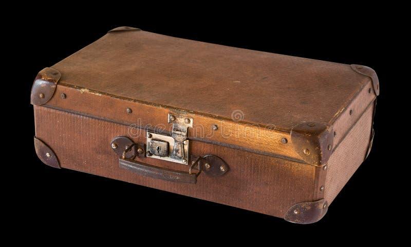 Старый затрапезный винтажный чемодан изолированный на черной предпосылке r стоковые изображения rf