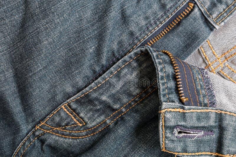 Старый конец-Вверх предпосылки голубых джинсов стоковая фотография rf