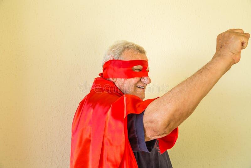 Старый кулак повышения супергероя стоковая фотография rf