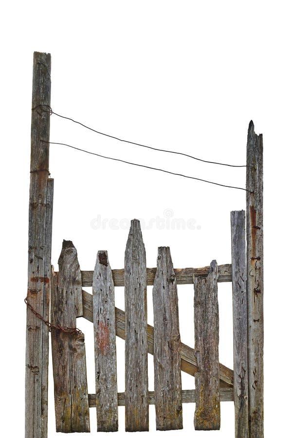 Старый постаретый выдержанный сельский загубленный серый деревянный строб, изолированный крупный план серого деревянного ворот вх стоковое фото rf
