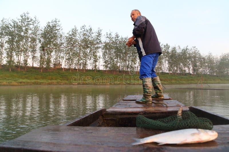 Старый рыболов стоковое фото