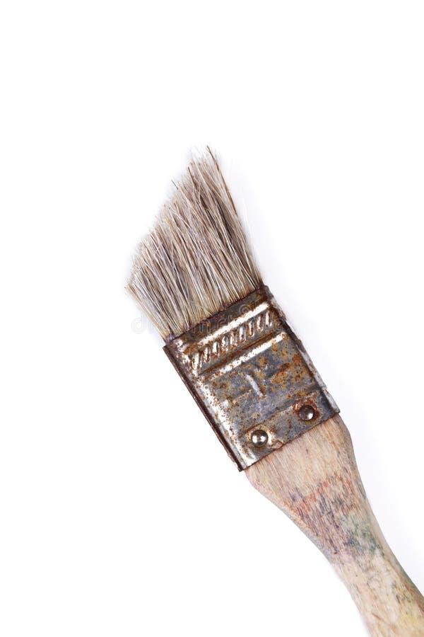 Старый стильный несенный вне ржавый paintbrush, винтажная щетка на белой предпосылке стоковая фотография rf