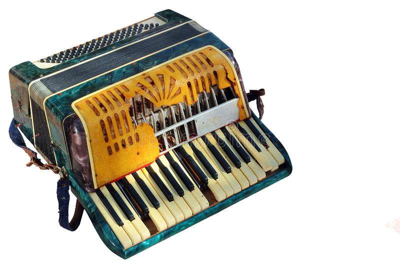 Старый сломанный аккордеон изолированный на белой предпосылке стоковое изображение rf