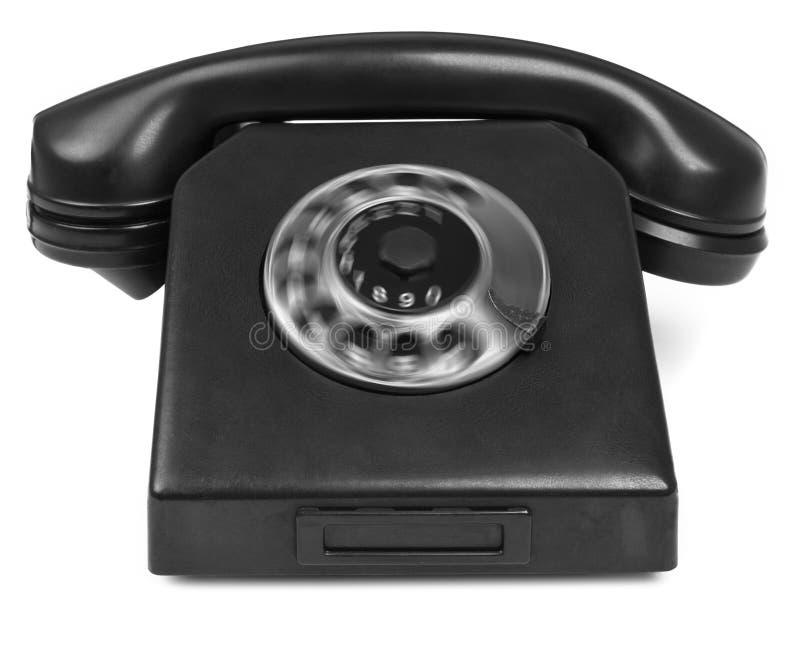 Старый телефон бакелита с spining шкалой стоковая фотография