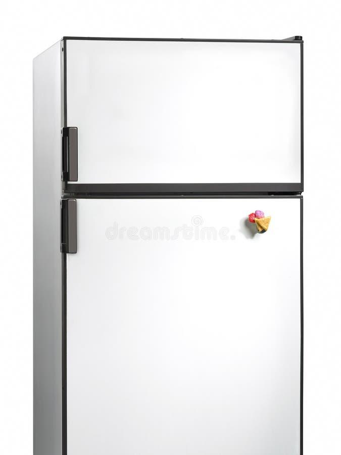 Старый холодильник с пластичным магнитом стоковое фото rf