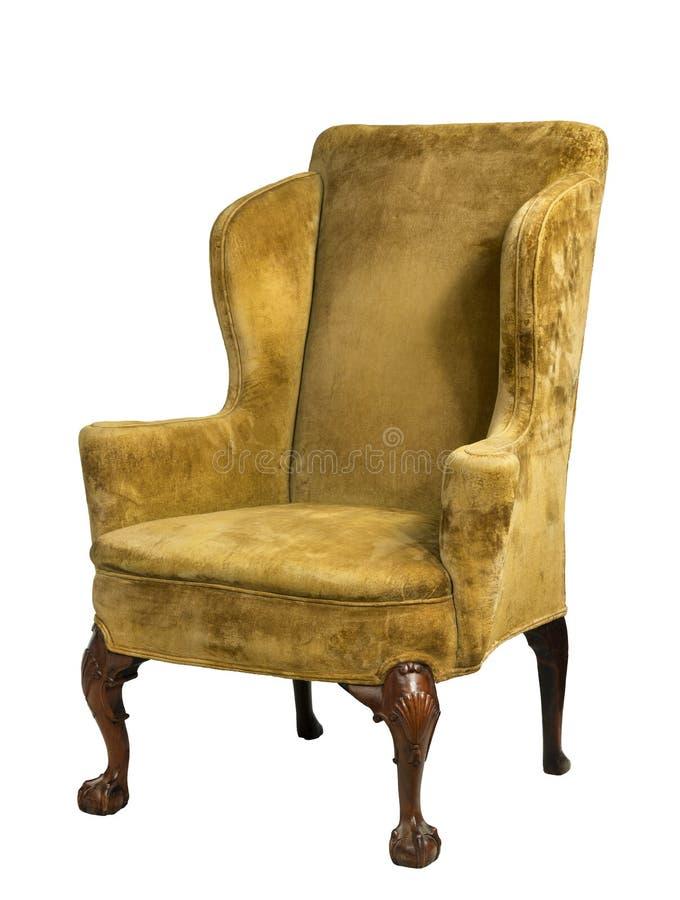 Старым первоначально обитый антиквариатом стул руки крыла изолированный на whi стоковое фото rf
