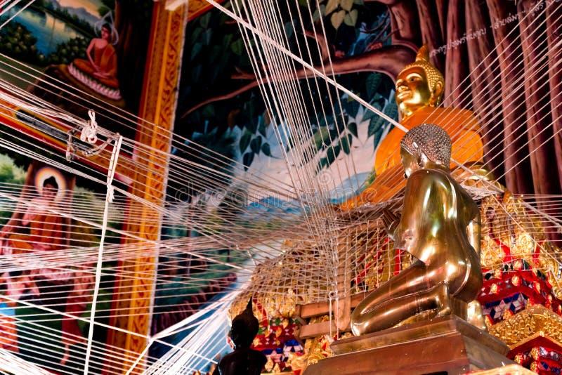 Статуя Будды внутри виска Таиланда стоковое фото