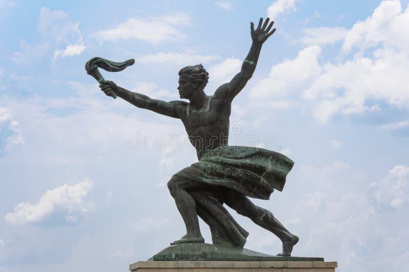 Статуя подателя факела стоковая фотография rf
