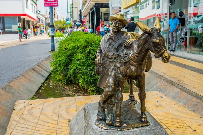 Статуя скотопромышленника с ослом в коммерчески центре стоковое изображение rf