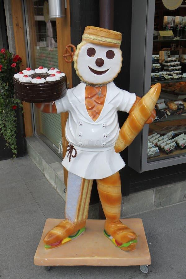Статуя человека хлебопекарни в Швейцарии стоковые изображения