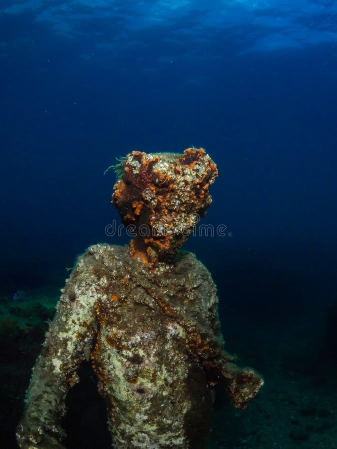 Статуя Dionysus с кроной плюща в Claudio's Ninfeum подводный, археология стоковое изображение
