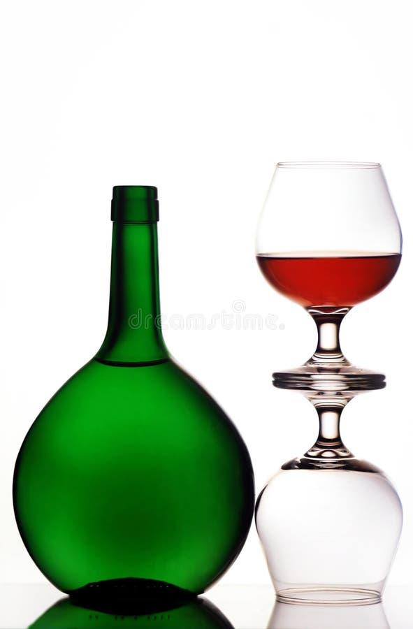 стекла конгяка бутылки стоковые изображения rf