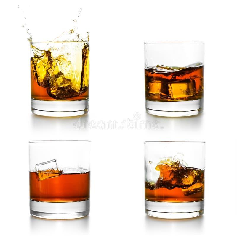 3 стекла при виски лить в их стоковое фото rf