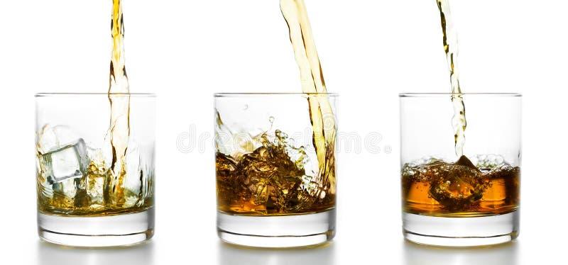 3 стекла при виски лить в их стоковое фото