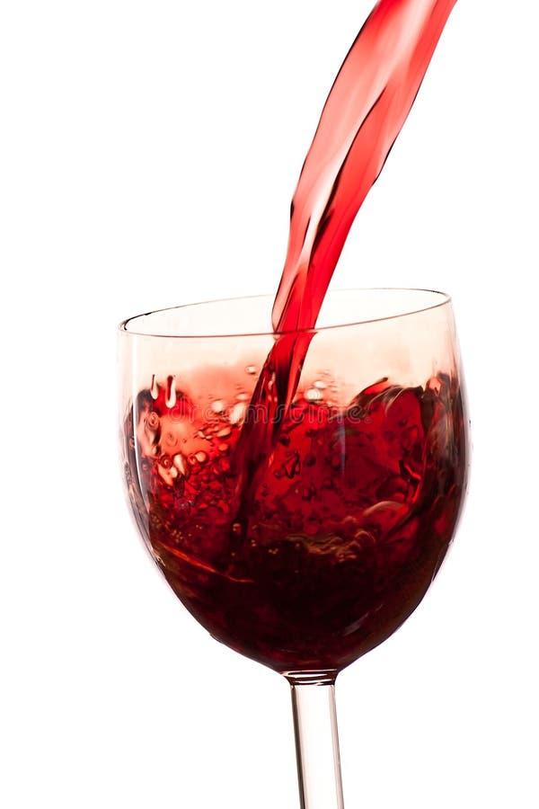 стекло предпосылки льет белое вино стоковые изображения rf