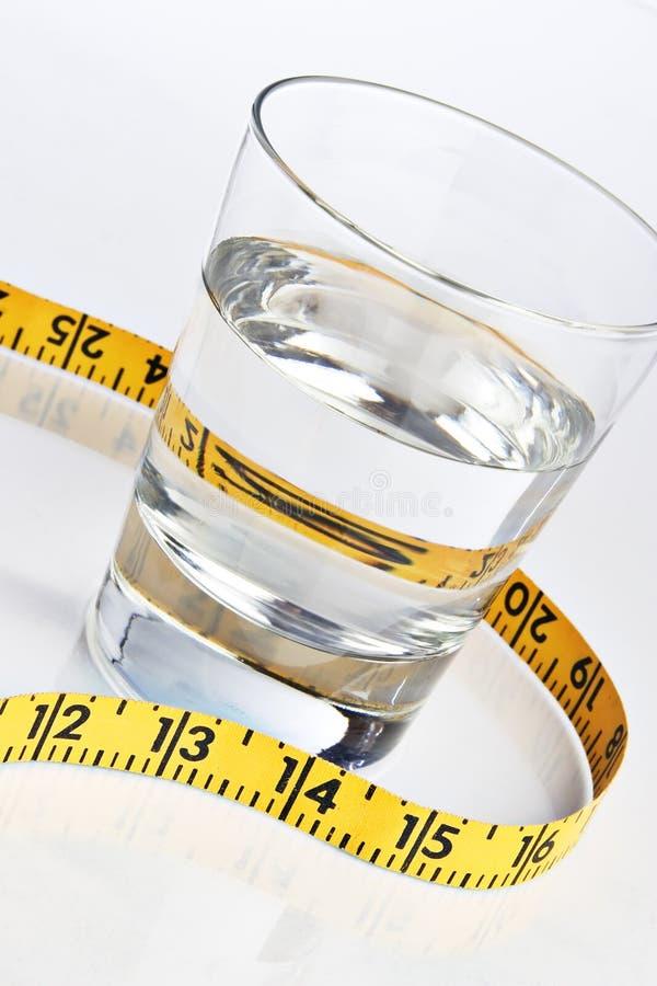 стеклянная вода ленты измерения стоковые фото