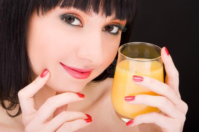 стеклянная женщина помадки сока стоковое изображение