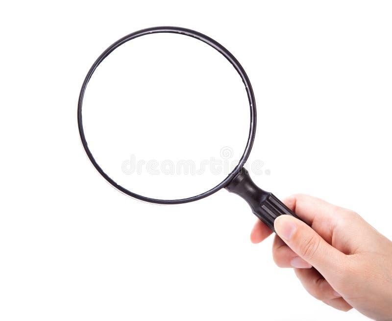 стеклянная рука увеличивая стоковое фото