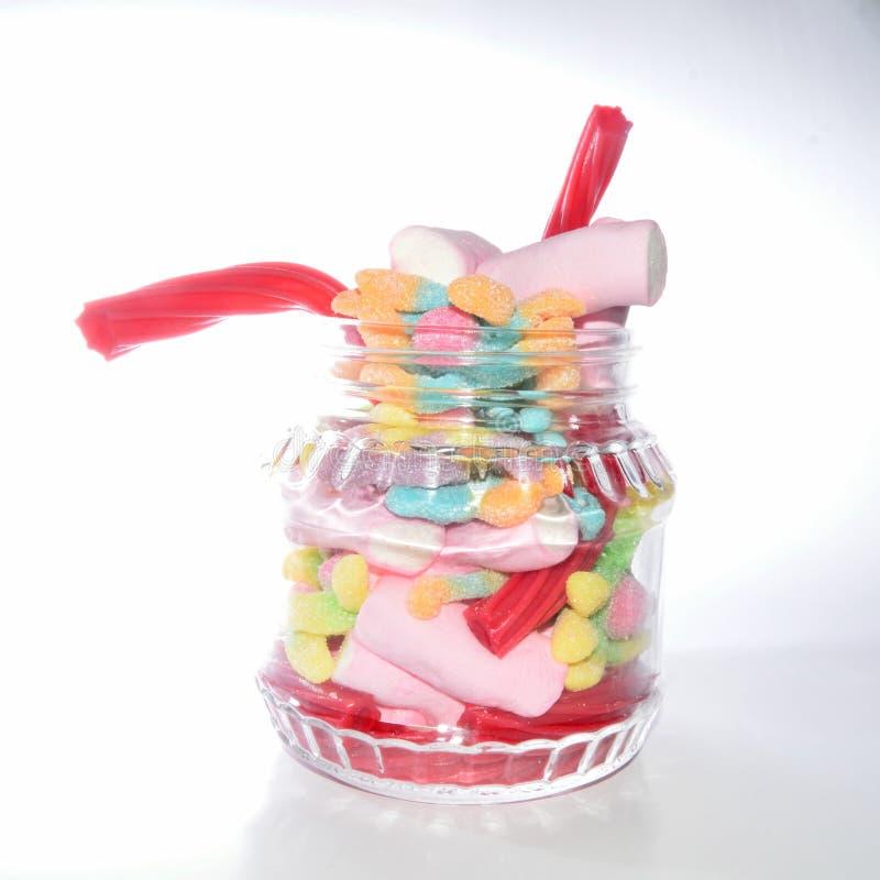 Стеклянный опарник с конфетами стоковые изображения rf