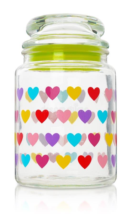 Стеклянный опарник с покрашенными сердцами Емкость для хранить изолированный дальше стоковое изображение rf