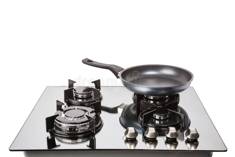 Стеклянный плита газа с сковородой стоковая фотография