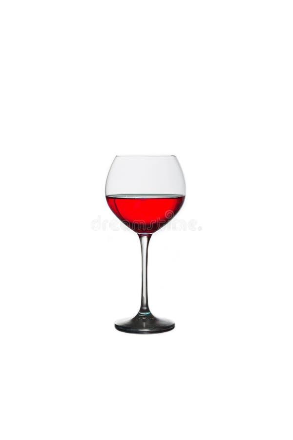 Стекло с красным вином на белой предпосылке стоковые фото