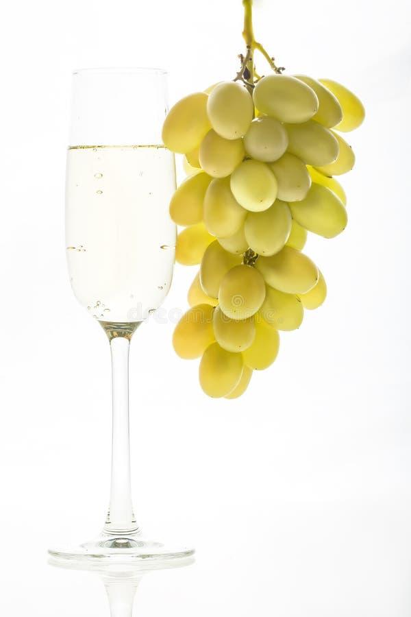Стекло шампанского и виноградин стоковое фото rf