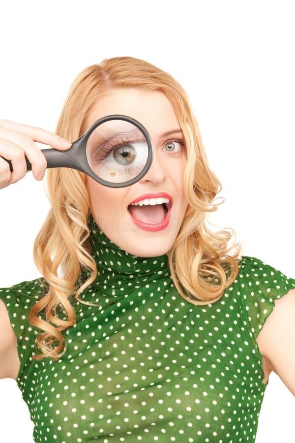стеклянная увеличивая женщина стоковые изображения